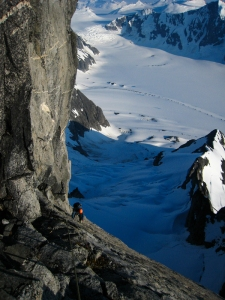 Jens Holsten on the third pitch (sixth overall) of the team's free variation on Burkett Needle. At mid-5th class, the technical difficulty was low enough to simply relish moving up golden stone while taking in the magnificent views.  <i>Max Hasson</i>